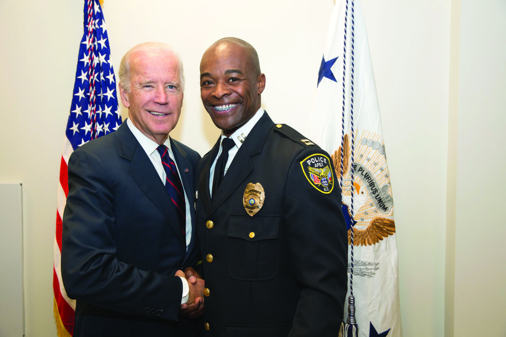 Vice President Joe Biden takes photos for the White House Champions of Change Law Enforcement and Youth Meeting in the Anteroom of South Court Auditorium in the Eisenhower Executive Office Building, Sept. 21, 2015. (Official White House Photo by David Lienemann)