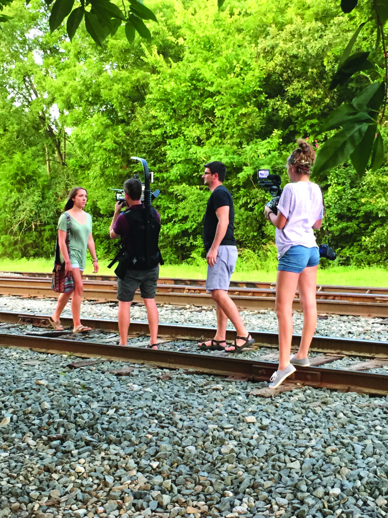 Speaking to Sparrows-filming on RR tracks